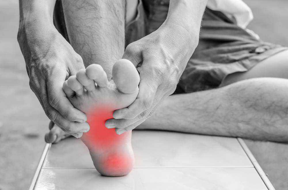 Chiropractor treating a patient for foot pain